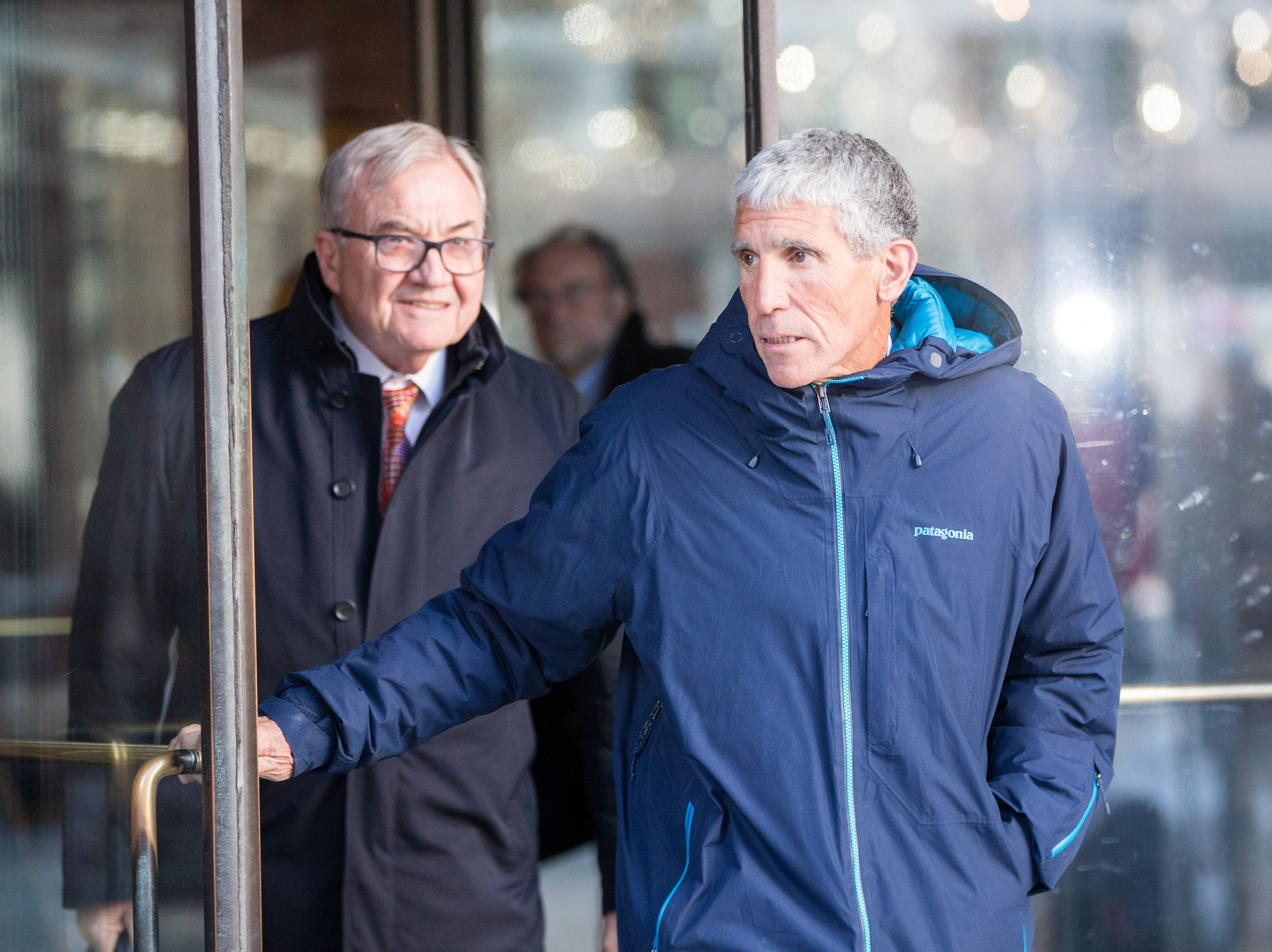 """William """"Rick"""" Singer leaves Boston Federal Court after being charged with racketeering conspiracy, money laundering conspiracy, conspiracy to defraud the United States, and obstruction of justice on March 12, 2019 in Boston. Singer is among several charged in alleged college admissions scam."""