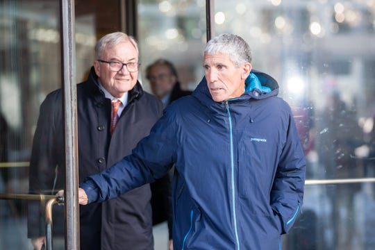 "William ""Rick"" Singer leaves Boston Federal Court after being charged with racketeering conspiracy, money laundering conspiracy, conspiracy to defraud the United States, and obstruction of justice on March 12, 2019 in Boston. Singer is among several charged in alleged college admissions scam."