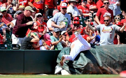 March 11: Cardinals third baseman Matt Carpenter makes a catch.