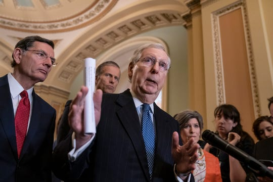 Senate Majority Leader Mitch McConnell, R-Ky., joined from left by Sen. John Barrasso, R-Wyo., Majority Whip John Thune, R-S.D., and Sen. Joni Ernst, R-Iowa, speaks with reporters during a news conference at the Capitol in Washington, D.C., on March 5, 2019.