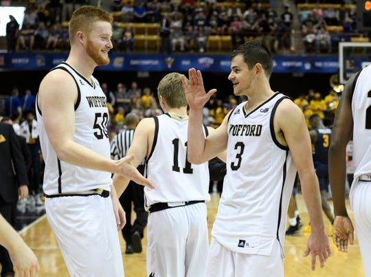 Wofford Terriers center Matthew Pegram (50) and Wofford Terriers guard Fletcher Magee (3) celebrate in the Southern Conference tournament.