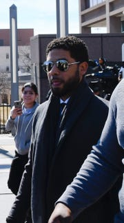 """Empire actor Jussie Smollett, center, leaves the Leighton Criminal Court Building after a hearing on Tuesday, March 12, 2019, in Chicago. A lawyer for Smollett said Tuesday that she would welcome cameras in the courtroom during the """"Empire"""" actor's trial on charges accusing him of lying to police, saying there has been a lot of leaked misinformation and that cameras would allow the public to """"see the evidence and the lack thereof."""""""