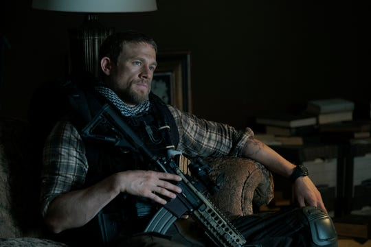 "Ironhead (Charlie Hunnam) is a former soldier hoping a big score might turn his life around in ""Triple Frontier."""
