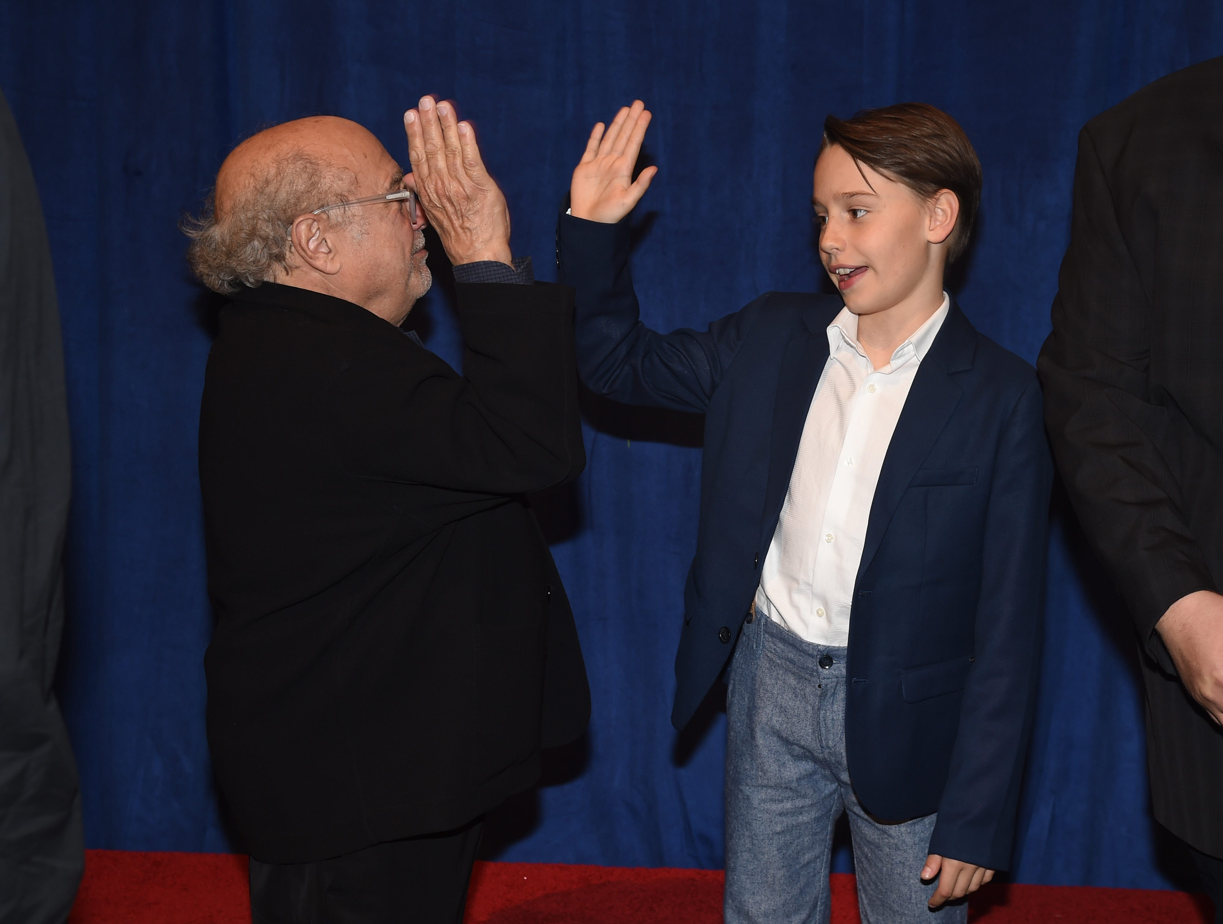 """LOS ANGELES, CALIFORNIA - MARCH 11: (L-R) Danny DeVito and Finley Hobbins attend the premiere of Disney's """"Dumbo"""" at El Capitan Theatre on March 11, 2019 in Los Angeles, California. (Photo by Kevin Winter/Getty Images) ORG XMIT: 775305574 ORIG FILE ID: 1135224388"""
