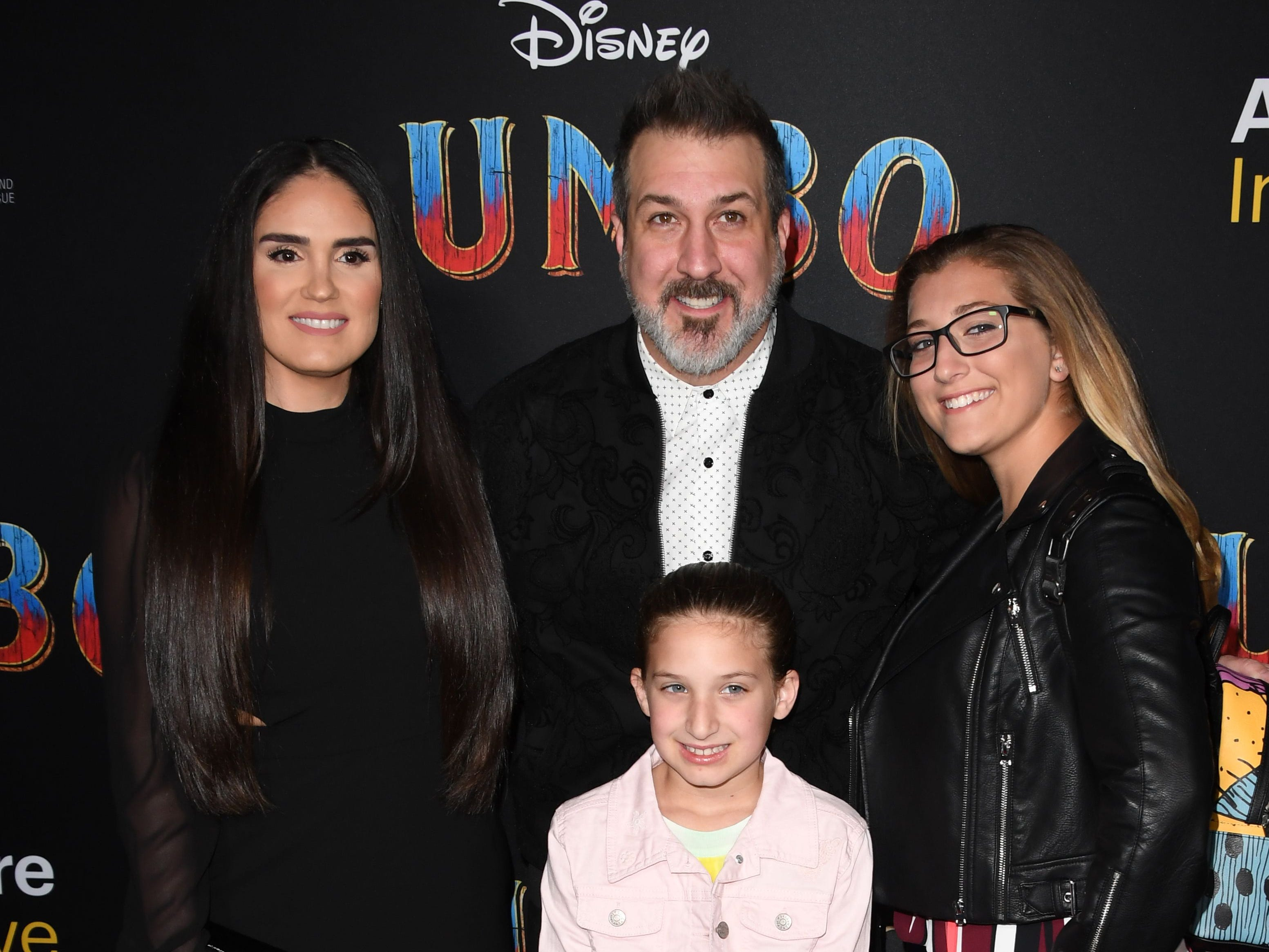 """US singer Joey Fatone (C) arrives with Izabel Araujo (L) and daughters Briahna Fatone (R) and Kloey Fatone for the world premiere of Disney's """"Dumbo"""" at El Capitan theatre on March 11, 2019 in Hollywood. (Photo by Robyn Beck / AFP)ROBYN BECK/AFP/Getty Images ORG XMIT: Premiere ORIG FILE ID: AFP_1EI2K6"""