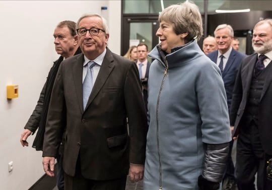 European Commission President Jean-Claude Juncke (left) welcomes Britain's Prime Minister Theresa May at the European Parliament in Strasbourg, eastern France, on Monday.