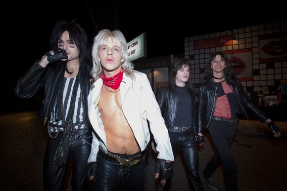 "Motley Crue bandmates Nikki Sixx (Douglas Booth, far left), Vince Neil (Daniel Webber), Mick Mars (Iwan Rheon) and Tommy Lee (Colson Baker) own the L.A. rock scene in ""The Dirt."""