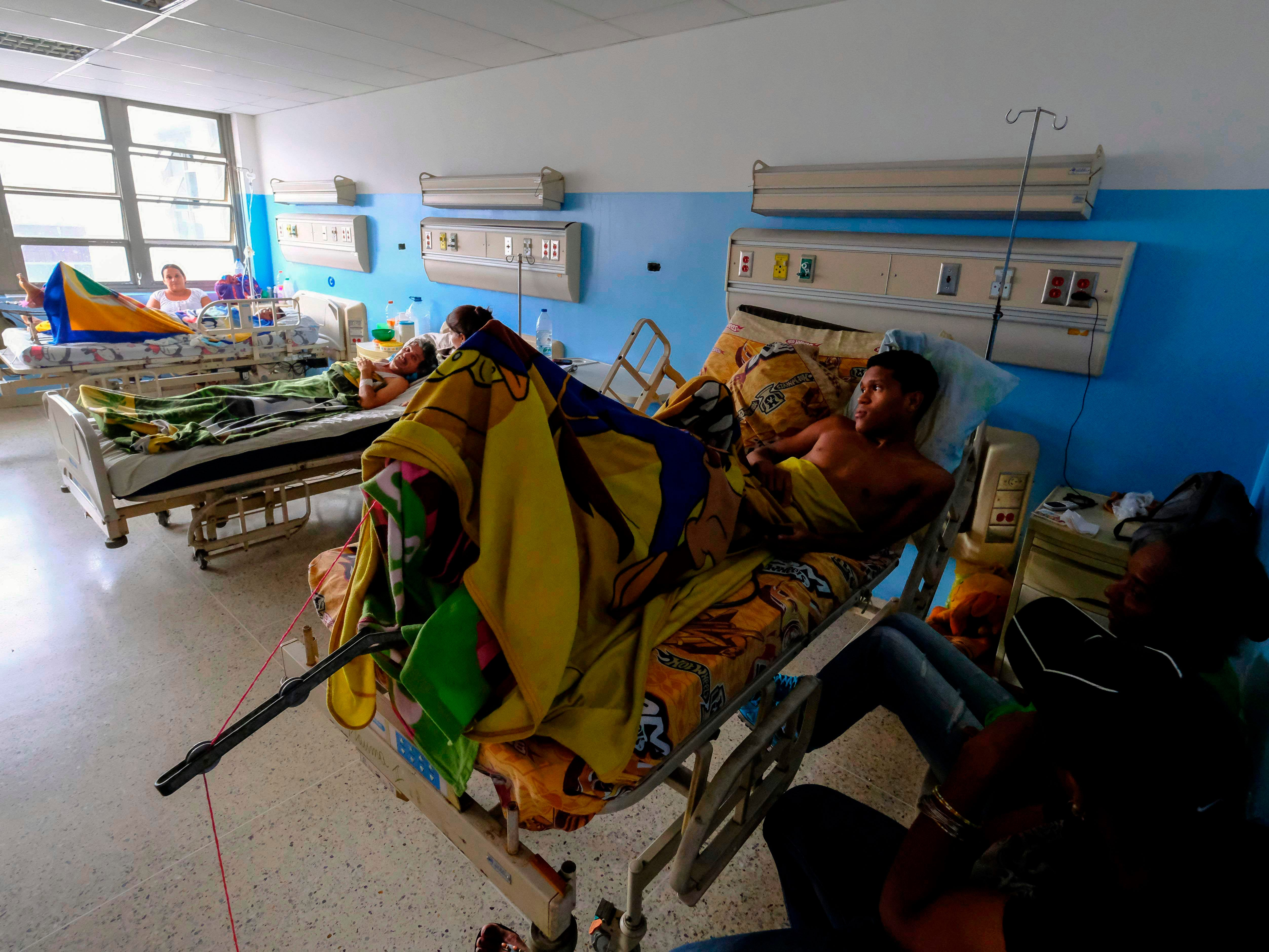 Patients lay on their beds at Miguel Perez Carreno hospital, in Caracas, during the worst power outage in Venezuela's history, on March 8, 2019.