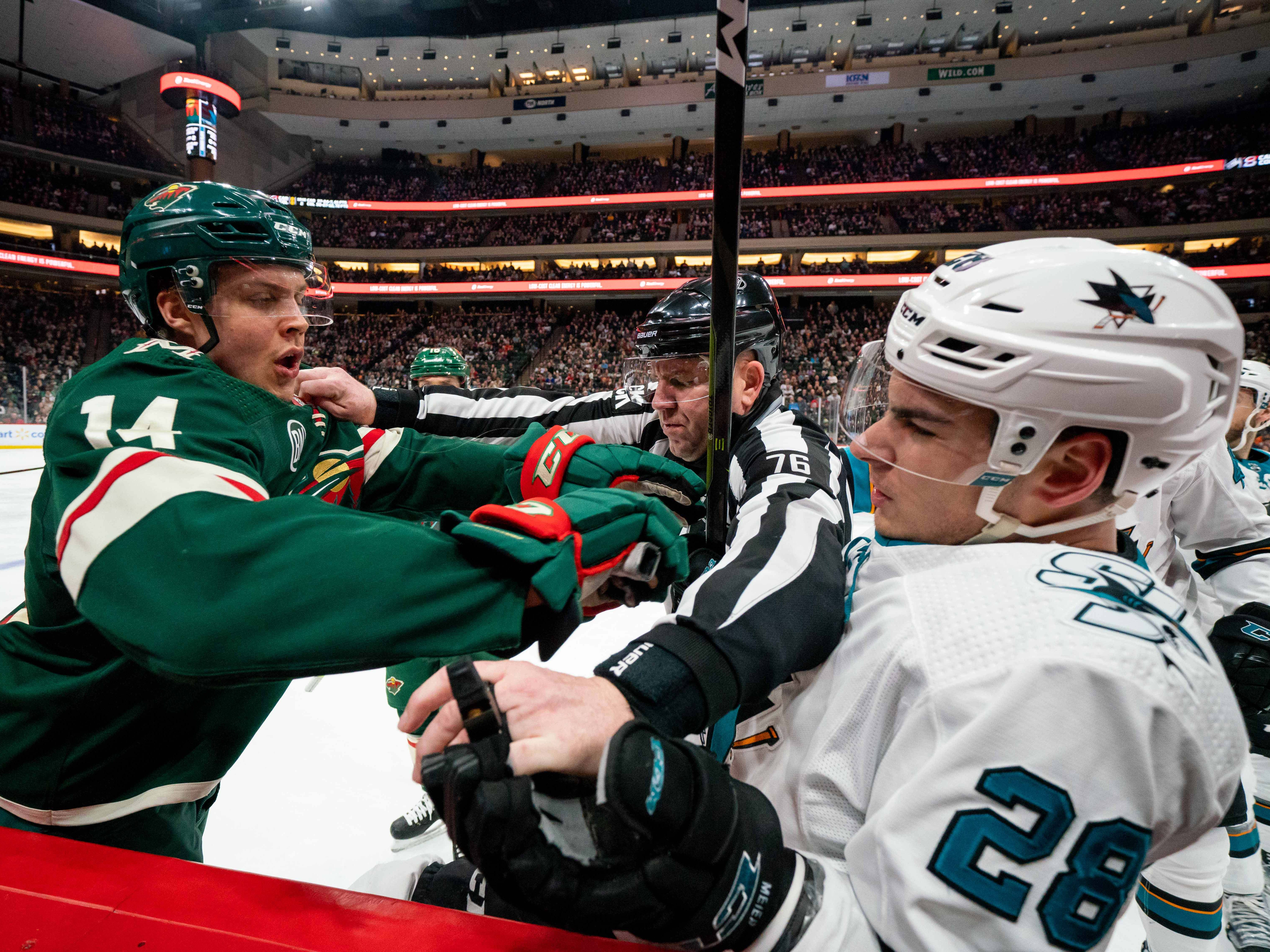 March 11: Minnesota Wild forward Joel Eriksson Ek (left) and San Jose Sharks forward Timo Meier (28) push each other in the third period at Xcel Energy Center. The Sharks won the game, 3-0.