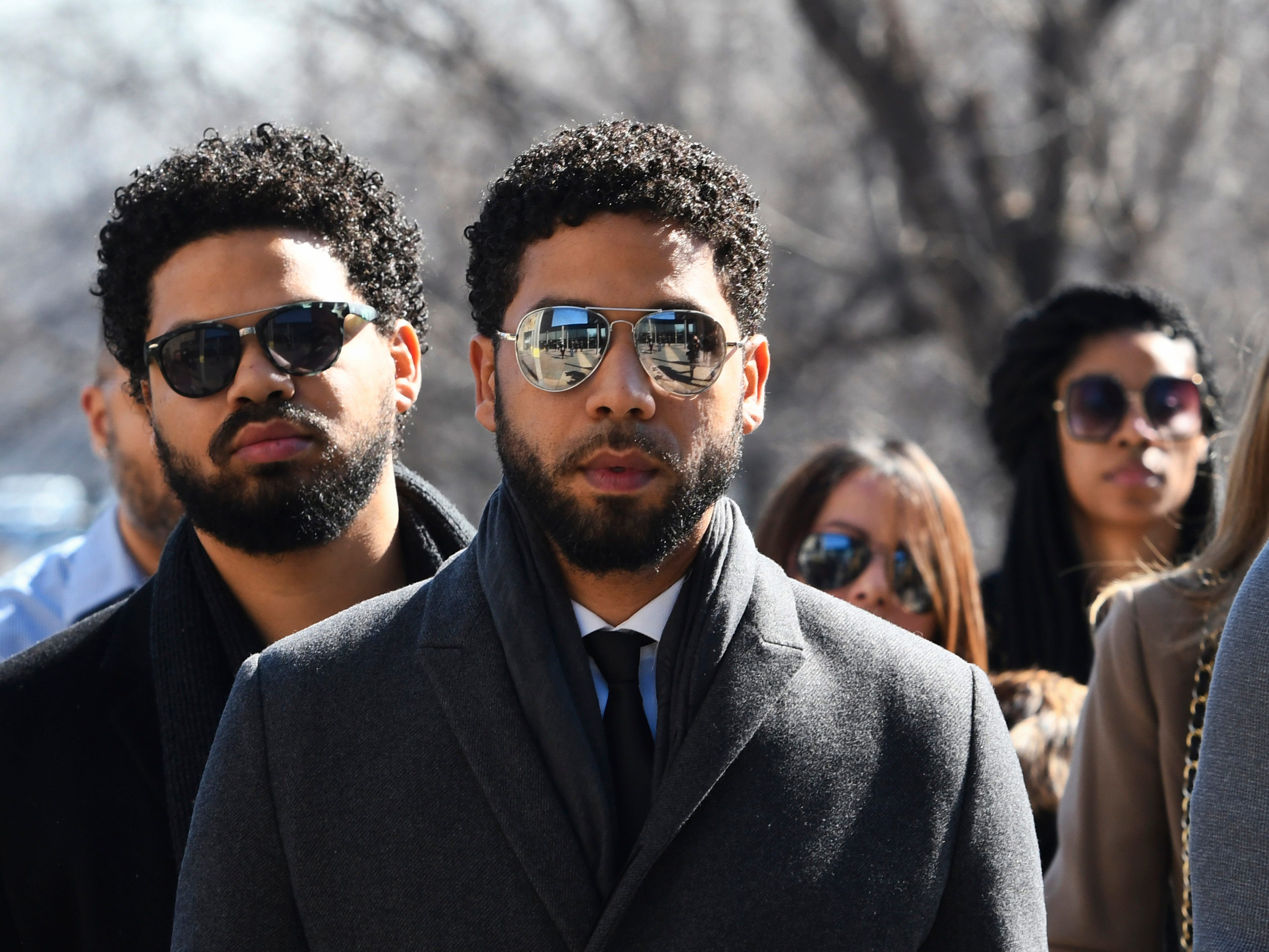 """Empire"" actor Jussie Smollett, center, arrives at Leighton Criminal Court Building for a hearing to discuss whether cameras will be allowed in the courtroom during his disorderly conduct case on Tuesday, March 12, 2019, in Chicago. A grand jury indicted Smollett last week on 16 felony counts accusing him of lying to the police about being the victim of a racist and homophobic attack by two masked men in downtown Chicago.(AP Photo/Matt Marton) ORG XMIT: ILMM109"