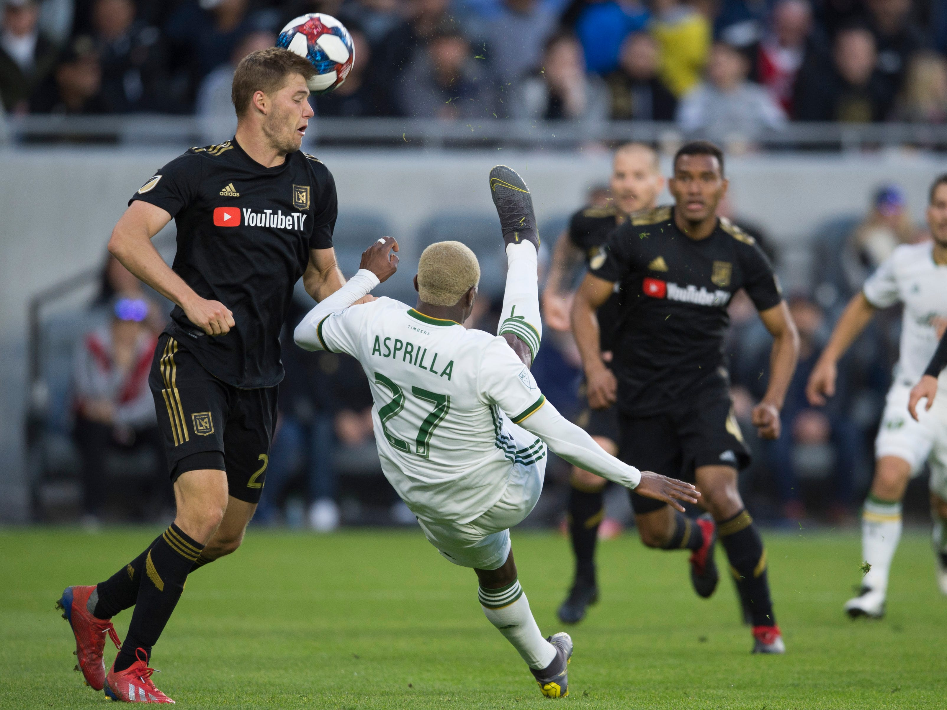 March 10: Portland Timbers midfielder Dairon Asprilla (27) attempts a shot while Los Angeles FC defender Walker Zimmerman (25) defends during the second half at Banc of California Stadium. LAFC won the game, 4-1.