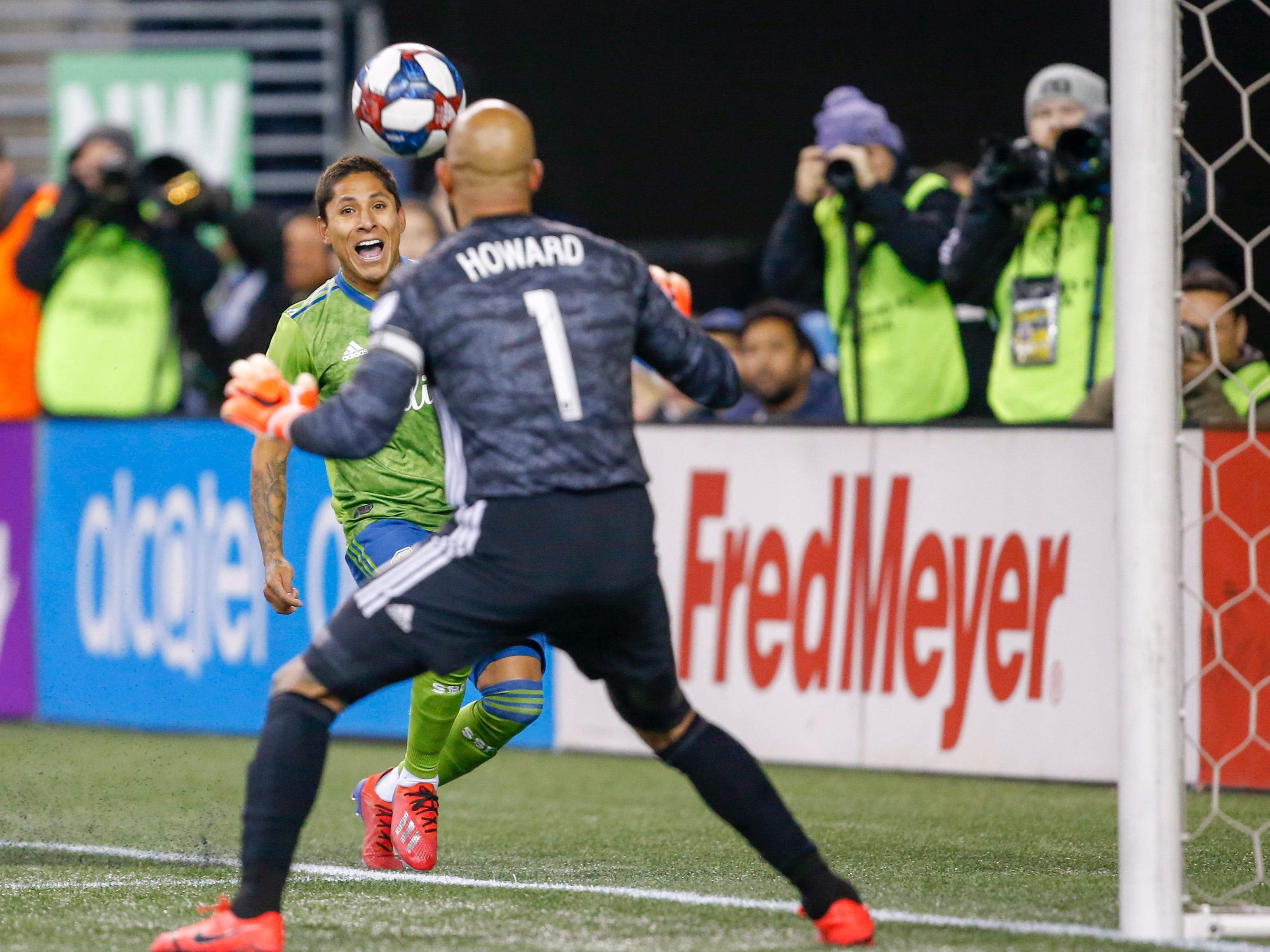 March 9: Seattle Sounders FC forward Raul Ruidiaz passes in side the end line against Colorado Rapids goalkeeper Tim Howard during the first half at CenturyLink Field. Seattle won the game, 2-0.