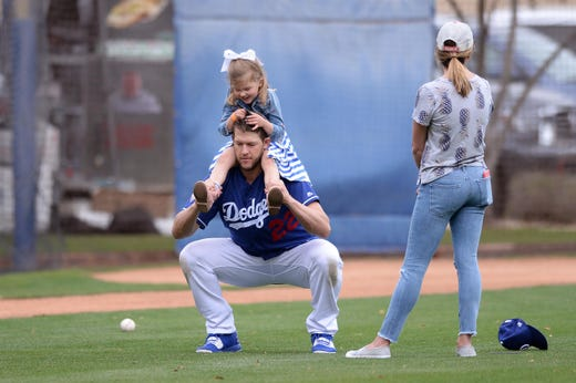 March 11: Dodgers starting pitcher Clayton Kershaw works out with daughter Cali Ann.