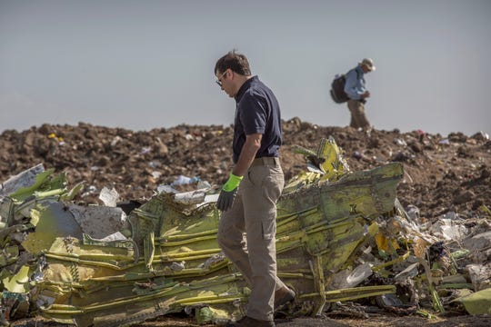 Foreign investigators examine wreckage at the scene where the Ethiopian Airlines Boeing 737 Max 8 crashed shortly after takeoff killing all 157 on board, near Bishoftu, or Debre Zeit, south of Addis Ababa, in Ethiopia March 12, 2019.