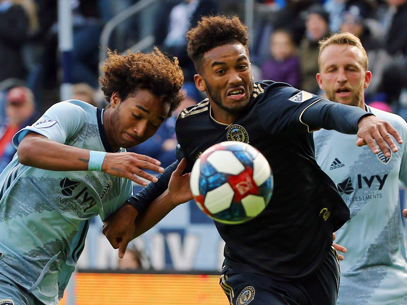 March 10: Sporting Kansas City forward Gianluca Busio (13) and Philadelphia Union defenseman Auston Trusty (26) fight for the ball in the second half at Children's Mercy Park. SKC won the game, 2-0.