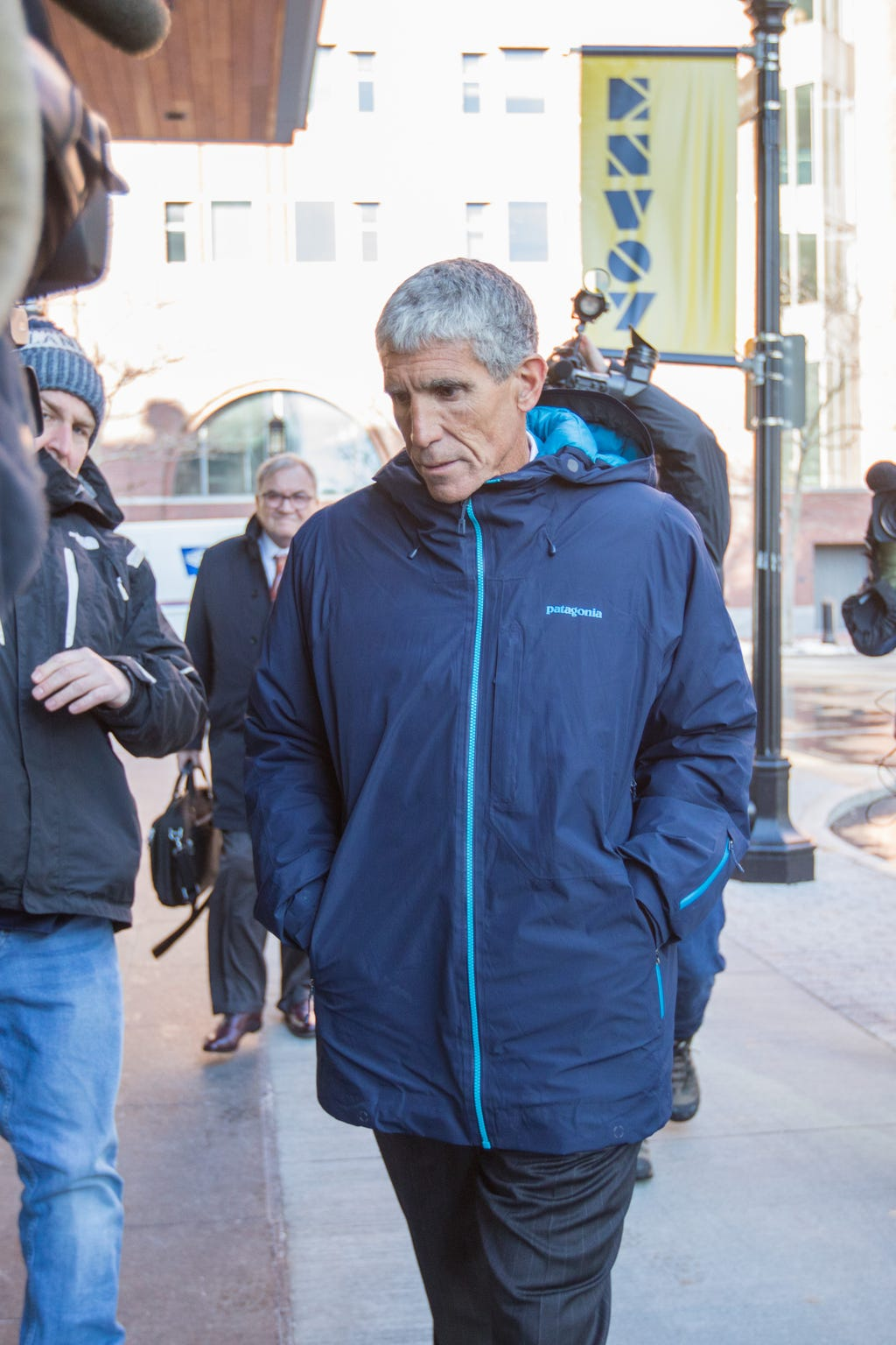"""William """"Rick"""" Singer leaves Boston Federal Court after being charged with racketeering conspiracy, money laundering conspiracy, conspiracy to defraud the United States, and obstruction of justice on March 12, 2019 in Boston, Massachusetts."""