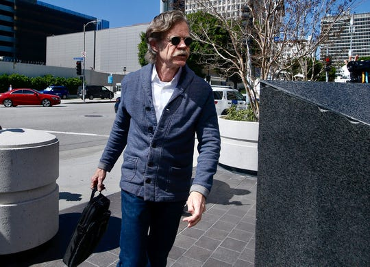 Actor William H. Macy arrives at the federal courthouse in Los Angeles, on Tuesday, March 12, 2019. Macy's wife, actress Felicity Huffman is among fifty people who were charged Tuesday in a scheme in which wealthy parents allegedly bribed college coaches and other insiders to get their children into some of the nation's most elite schools.