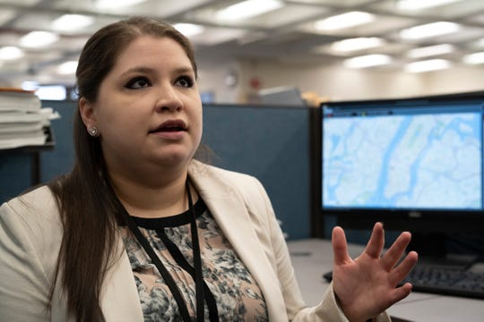 In this Feb. 11, 2019, photo, Rebecca Shutt, who works in the New York Police Department's Office of Crime Control Strategies, speaks in New York. Shutt utilizes a software called Patternizr, which allows crime analysts to compare robbery, larceny and theft incidents to the millions of crimes logged in the NYPD's database, aiding their hunt for crime patterns.