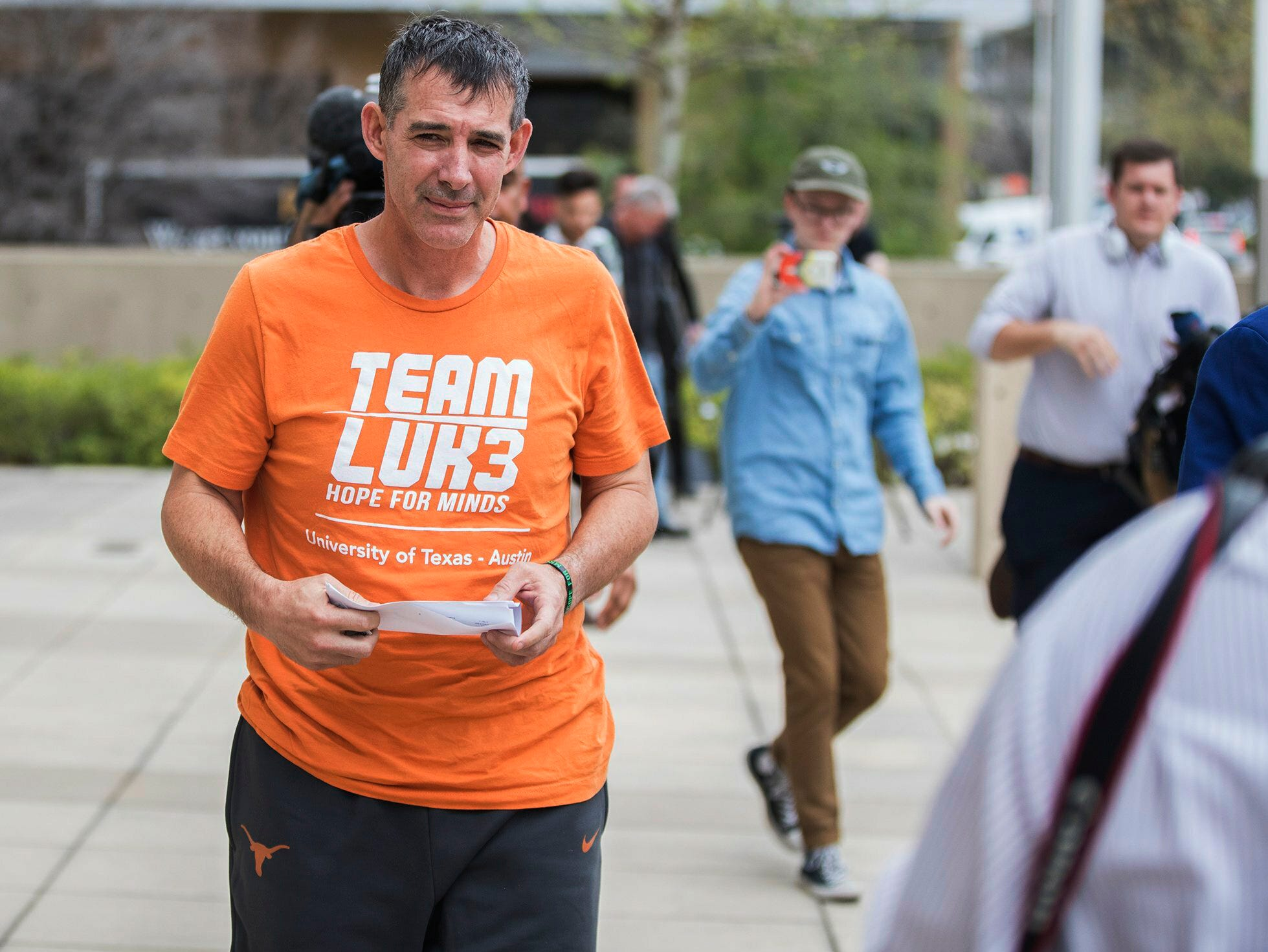 Texas men's tennis coach Michael Center walks away from the United States Federal Courthouse in Austin, Texas, on March 12, 2019. Center is among a few people in the state charged in a scheme that involved wealthy parents bribing college coaches and others to gain admissions for their children at top schools, federal prosecutors said.