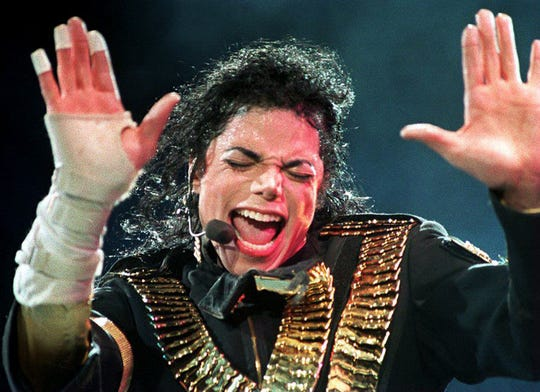 """Michael Jackson performing in Singapore in 1993. Sales and streams of the late singer's music have increased since HBO's controversial """"Leaving Neverland"""" brought his sexual abuse allegations back into the headlines."""