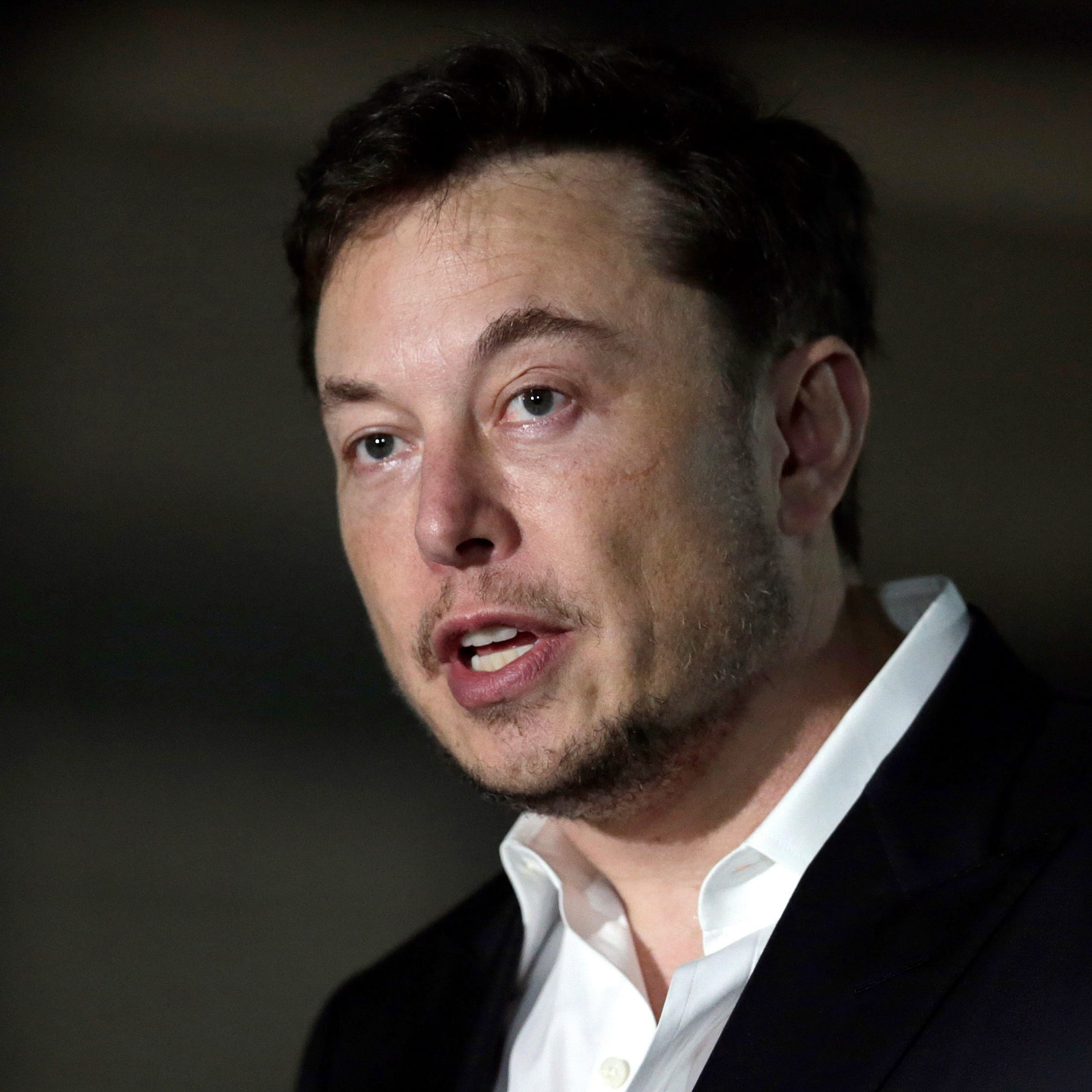 Attorneys tell a federal judge that Tesla CEO Elon Musk shouldn't be found in contempt because he didn't violate a securities fraud settlement.