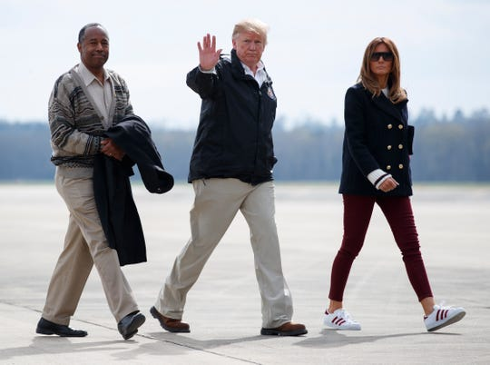 President Donald Trump, first lady Melania Trump and Secretary of Housing and Urban Development Ben Carson walk from Marine One to board Air Force One at Lawson Army Airfield, Fort Benning, Ga., Friday, March 8, 2019, en route Palm Beach International Airport in West Palm Beach, Fla., after visiting Lee County, Ala., where tornados killed 23 people. (AP Photo/Carolyn Kaster) ORG XMIT: GACK150