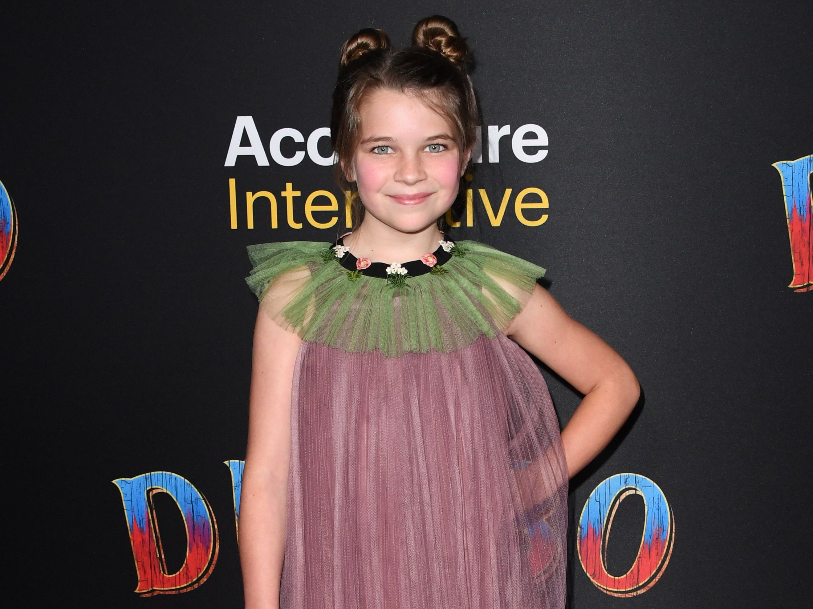 """Actress Raegan Revord arrives for the world premiere of Disney's """"Dumbo"""" at El Capitan theatre on March 11, 2019 in Hollywood. (Photo by Robyn Beck / AFP)ROBYN BECK/AFP/Getty Images ORG XMIT: Premiere ORIG FILE ID: AFP_1EI154"""