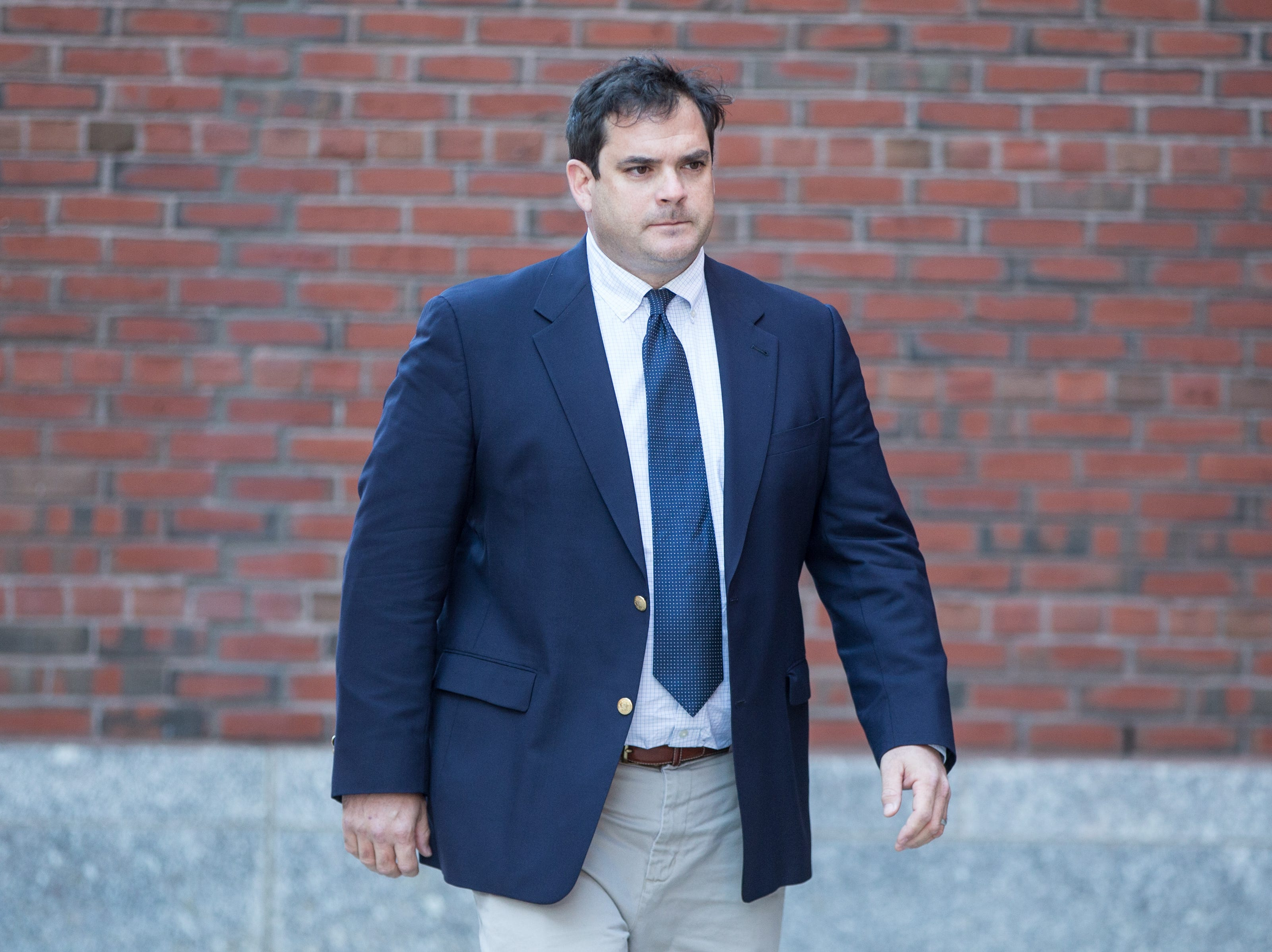 Stanford sailing coach John Vandemoer arrives at Boston Federal Court for an arraignment on March 12, 2019, in Boston. John Vandemoer is among several charged in alleged college admissions scam.