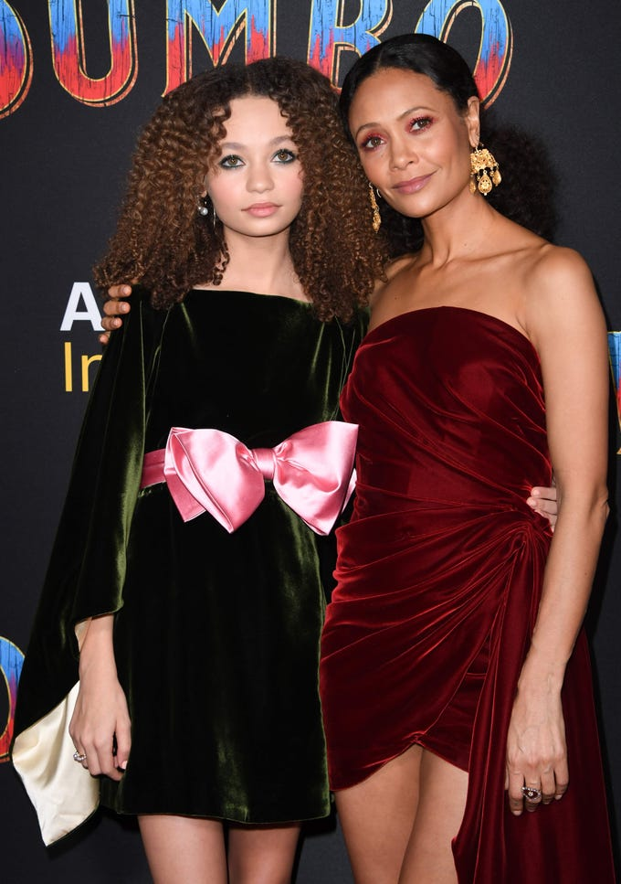 """US actress Nico Parker (L) and her mom actress Thandie Newton (R) arrive for the world premiere of Disney's """"Dumbo"""" at El Capitan theatre on March 11, 2019 in Hollywood. (Photo by Robyn Beck / AFP)ROBYN BECK/AFP/Getty Images ORG XMIT: Premiere ORIG FILE ID: AFP_1EI1U9"""