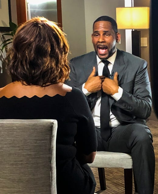epa07420408 R&B singer R. Kelly (R) speaks during an interview with CBS This Morning's Gayle King (L) at the Trump Hotel in Chicago, Illinois, USA, 05 March 2019 (Issued 07 March 2019). Kelly, who faces criminal sexual abuse charges, has failed to pay more than 161 thousand US dollar in back child support. He was taken into custody to be returned to the Cook County Jail after failing to pay the full amount he owes on 07 March.  EPA-EFE/JAKE BARLOW   EDITORIAL USE ONLY/NO SALES ORG XMIT: THM01