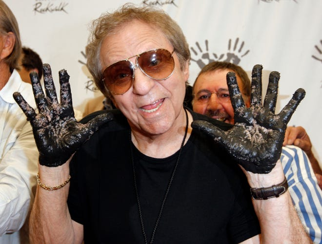 Hal Blaine holds up his hands after placing them in wet cement with Don Randi and Glen Campbell, representing The Wrecking Crew at an induction ceremony for Hollywood's RockWalk on June 25, 2008. Drummer Blaine, who played on many of the biggest hits in music history, died of natural causes March 11, 2019, at his home in Palm Desert, California. He was 90.