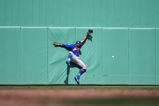 March 9: Mets left fielder Keon Broxton crashes into the wall attempting to make a catch.