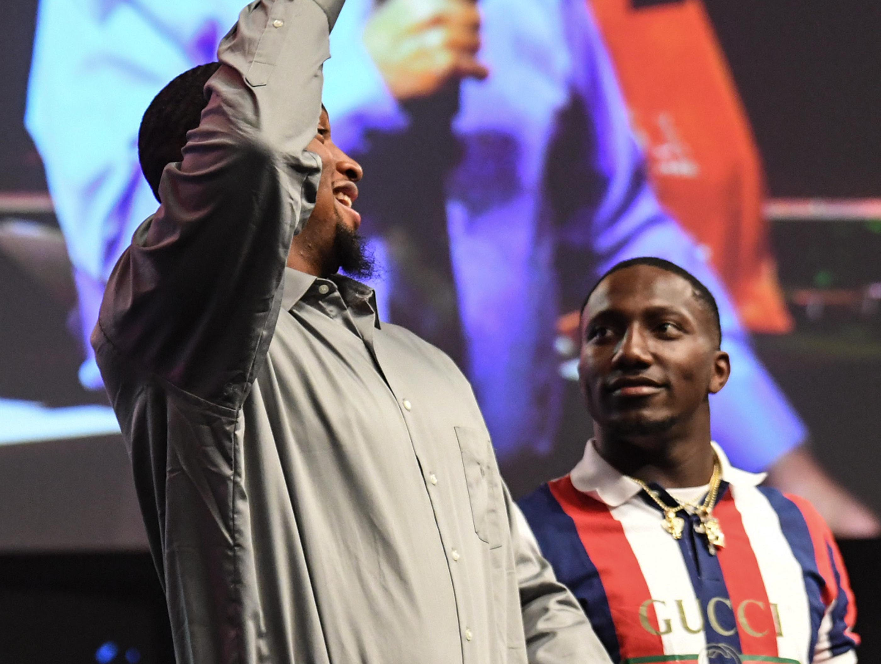Clelin Ferrell and Deebo Samuel, former Clemson Tigers and South Carolina Gamecocks football players, speak during the Coaches 4 Character event at Relentless Church in Greenville Tuesday.