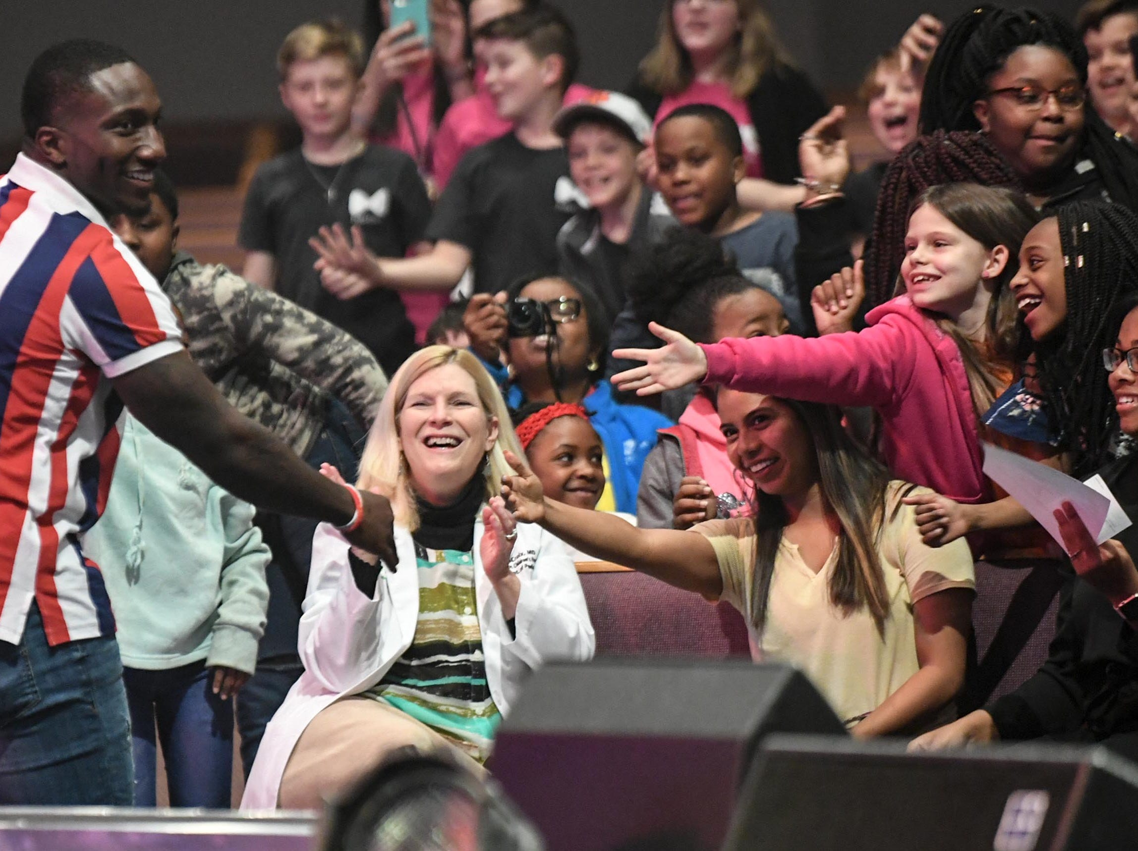Deebo Samuel, former South Carolina Gamecock football player, greets fans attending  the Coaches 4 Character event at Relentless Church in Greenville Tuesday.