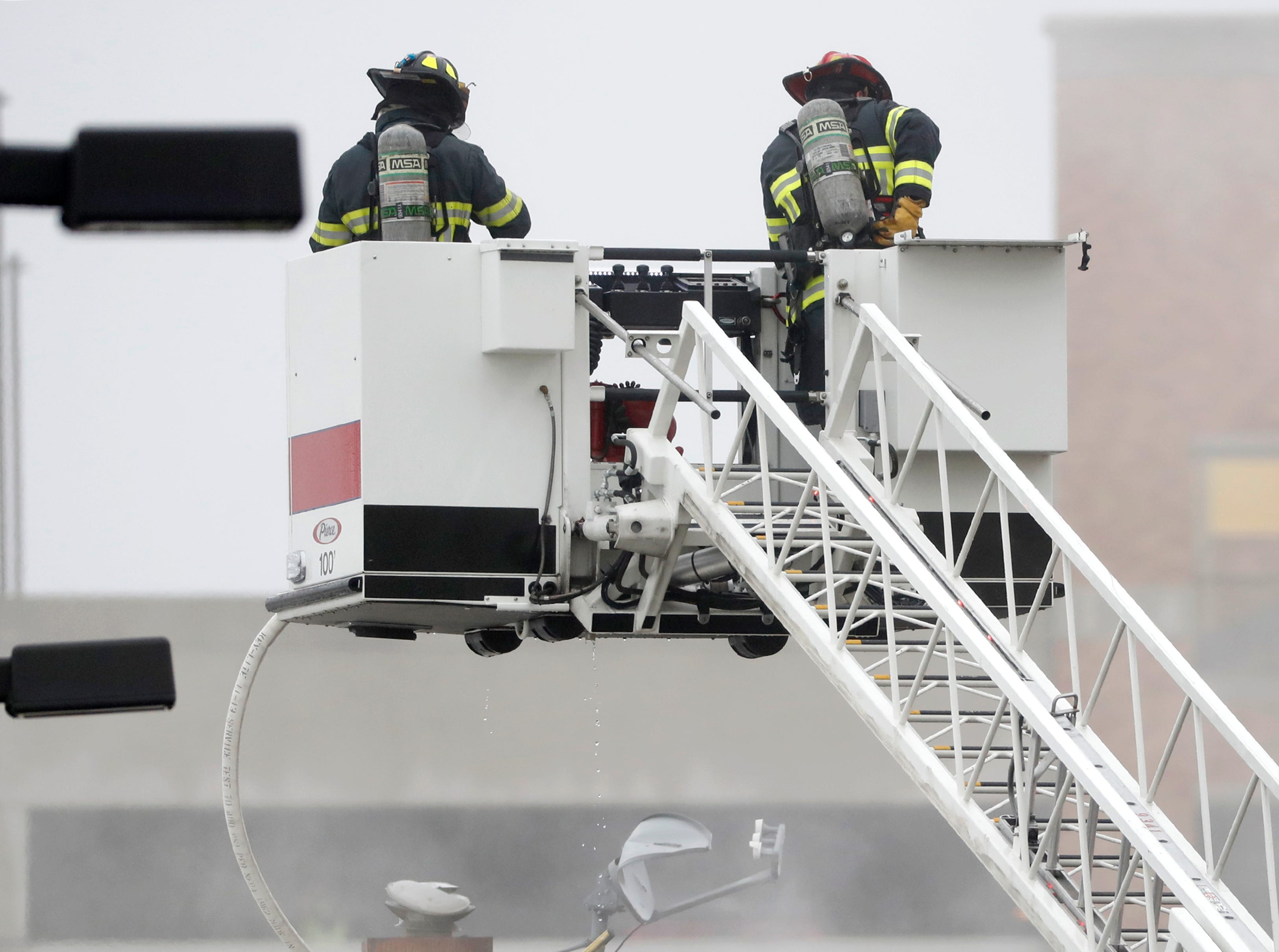 Firefighters continue to work the scene of a fire in the building that houses Author's Kitchen and Bar from the roof of Apollon in downtown Appleton on the corner of West Washington and North Appleton Streets Wednesday, March 13, 2019, in Appleton, Wis. Danny Damiani/USA TODAY NETWORK-Wisconsin