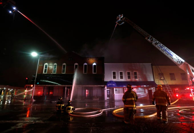 Firefighters work to put out a fire in downtown Appleton on the corner of West Washington and North Appleton Streets Wednesday, March 13, 2019, in Appleton, Wis. Danny Damiani/USA TODAY NETWORK-Wisconsin