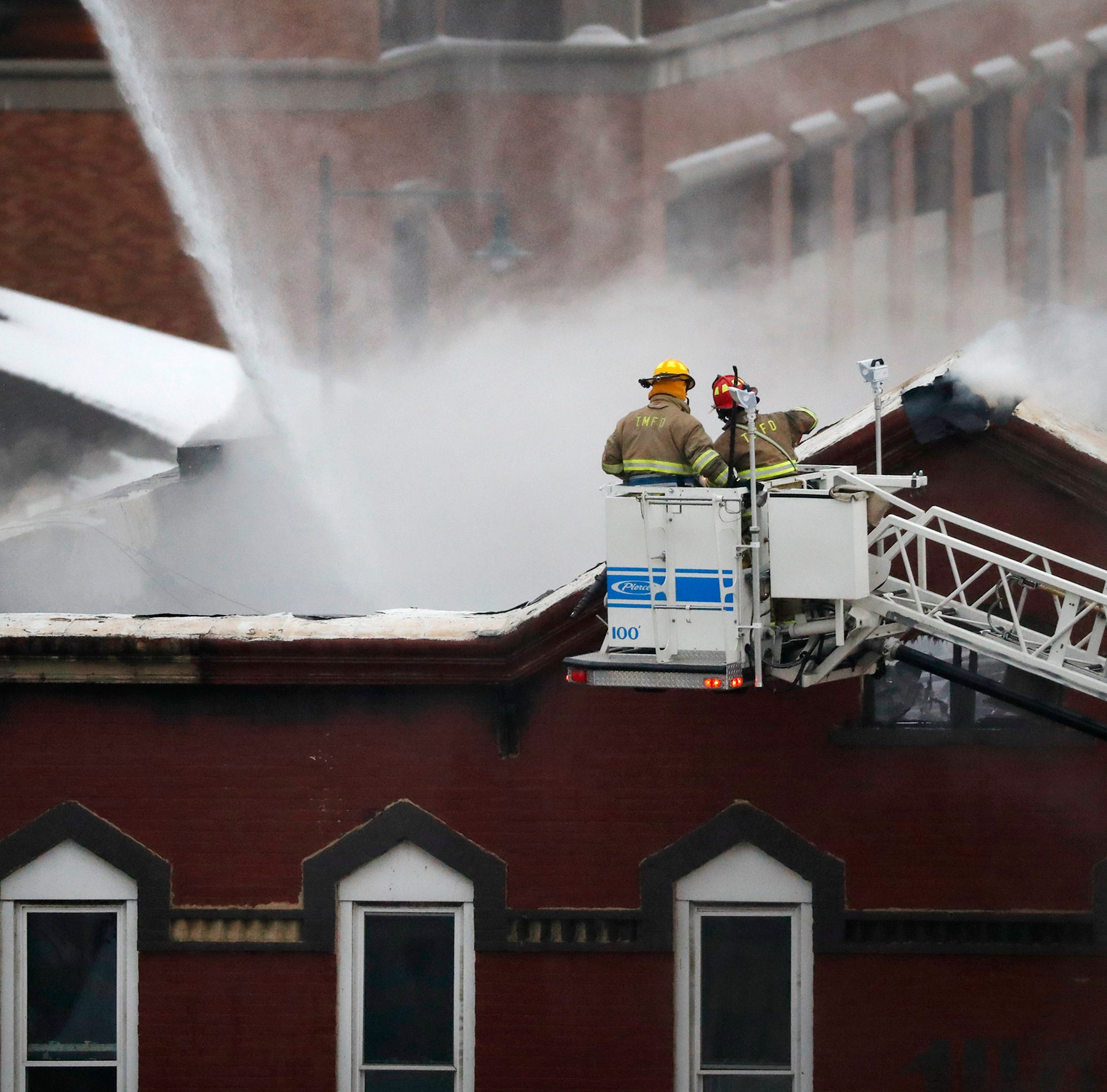 Roads partially closed near Author's Kitchen + Bar after fire guts downtown building