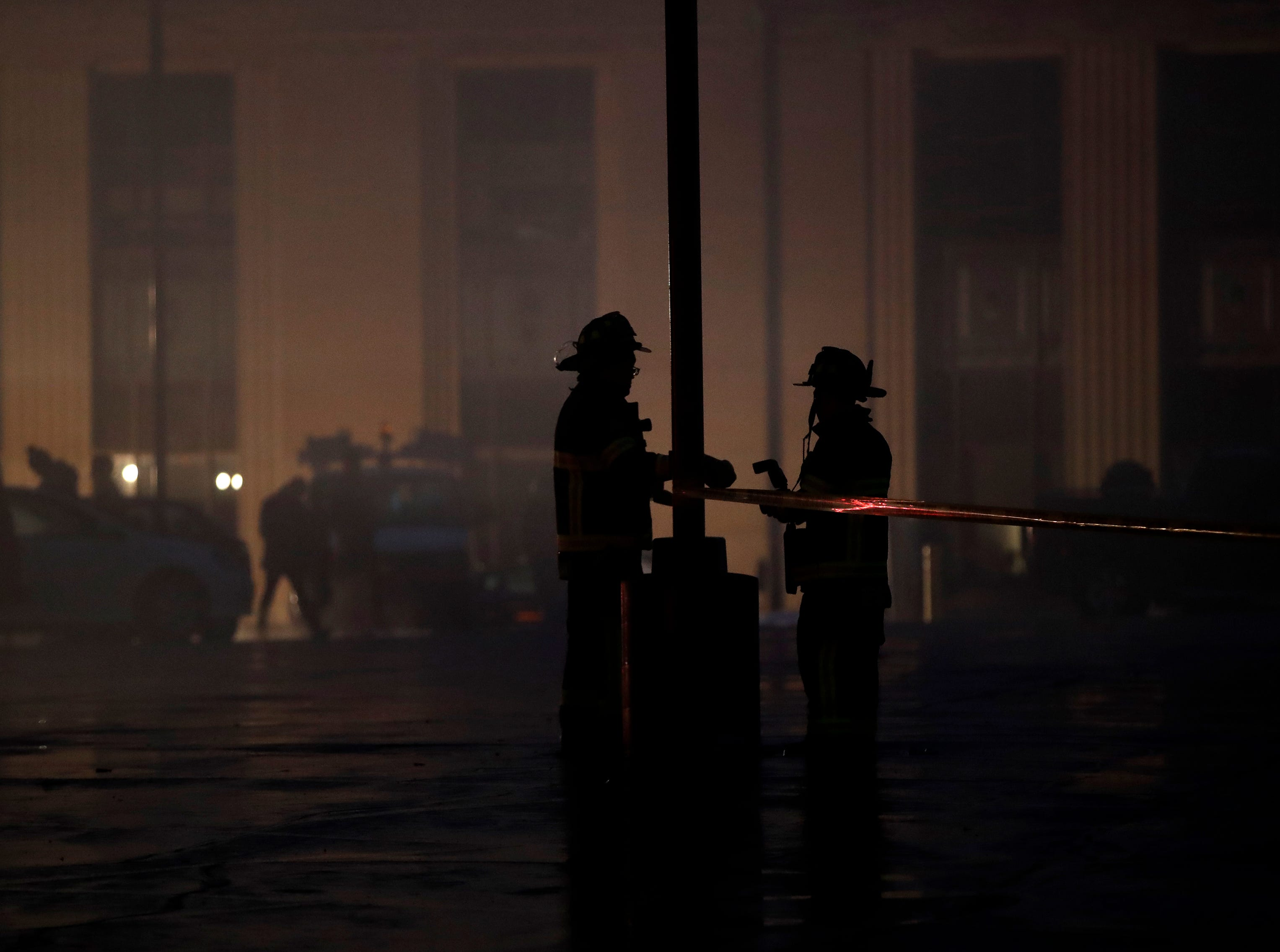 Firefighters put up caution tape at the scene of a structure fire in downtown Appleton on the corner of West Washington and North Appleton Streets Wednesday, March 13, 2019, in Appleton, Wis. Danny Damiani/USA TODAY NETWORK-Wisconsin