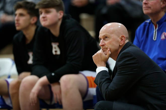 Appleton West coach Brennan Hussey keeps his eyes on the action against Wausau West during a nonconference boys basketball game Dec. 28 in Appleton.