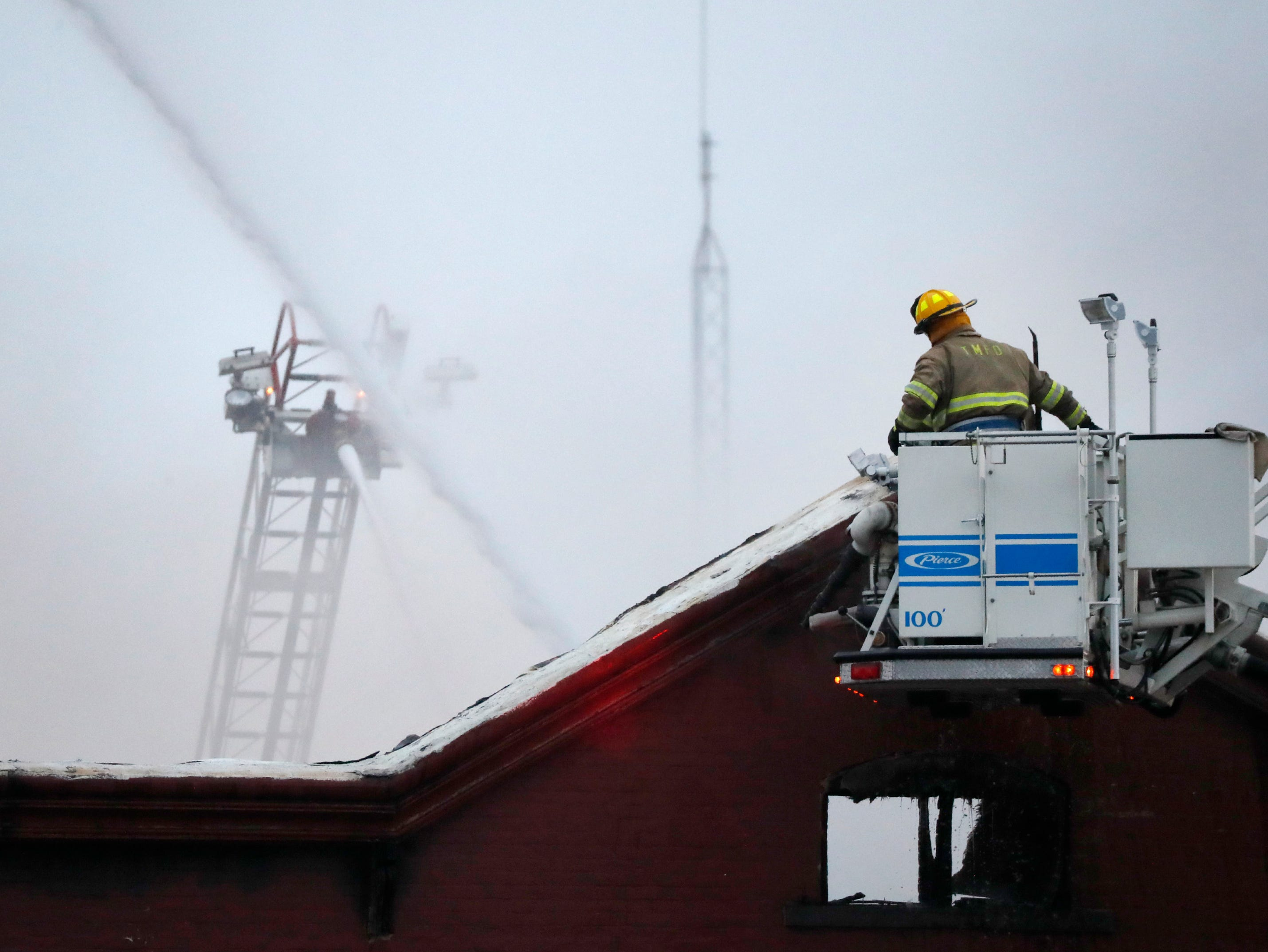 Firefighters work the scene of a structure fire in downtown Appleton on the corner of West Washington and North Appleton Streets Wednesday, March 13, 2019, in Appleton, Wis. Danny Damiani/USA TODAY NETWORK-Wisconsin