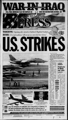 """A gung-ho Thursday, March 20, 2003 edition of the Asbury Park Press comes complete with """"a full-page American flag for display"""" on page A11, as the United States invades Iraq on a foreign policy of preemptive war adopted after the 9/11 terrorist attacks."""