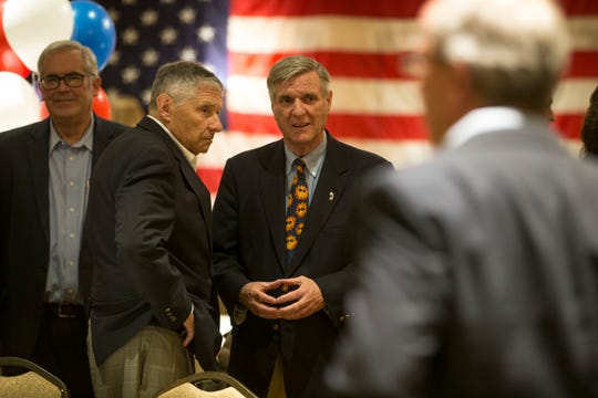 George Gilmore speaks with state Sen. Robert W. Singer, R-Ocean (second from left) at what would be Gilmore's last major public event as chairman of the Ocean County Republican Party: its annual nominating convention at the Days Hotel by Wyndham in Toms River on March 13, 2019.