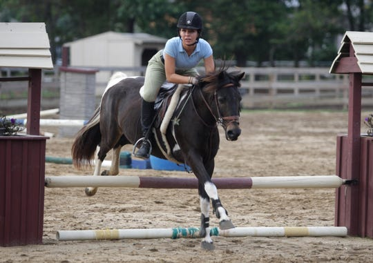 Ellen Bissey of Toms River practices jumps with her horse Justin, a 13-year-old pinto at West Wind Stable in Toms River in this 2010 file photo