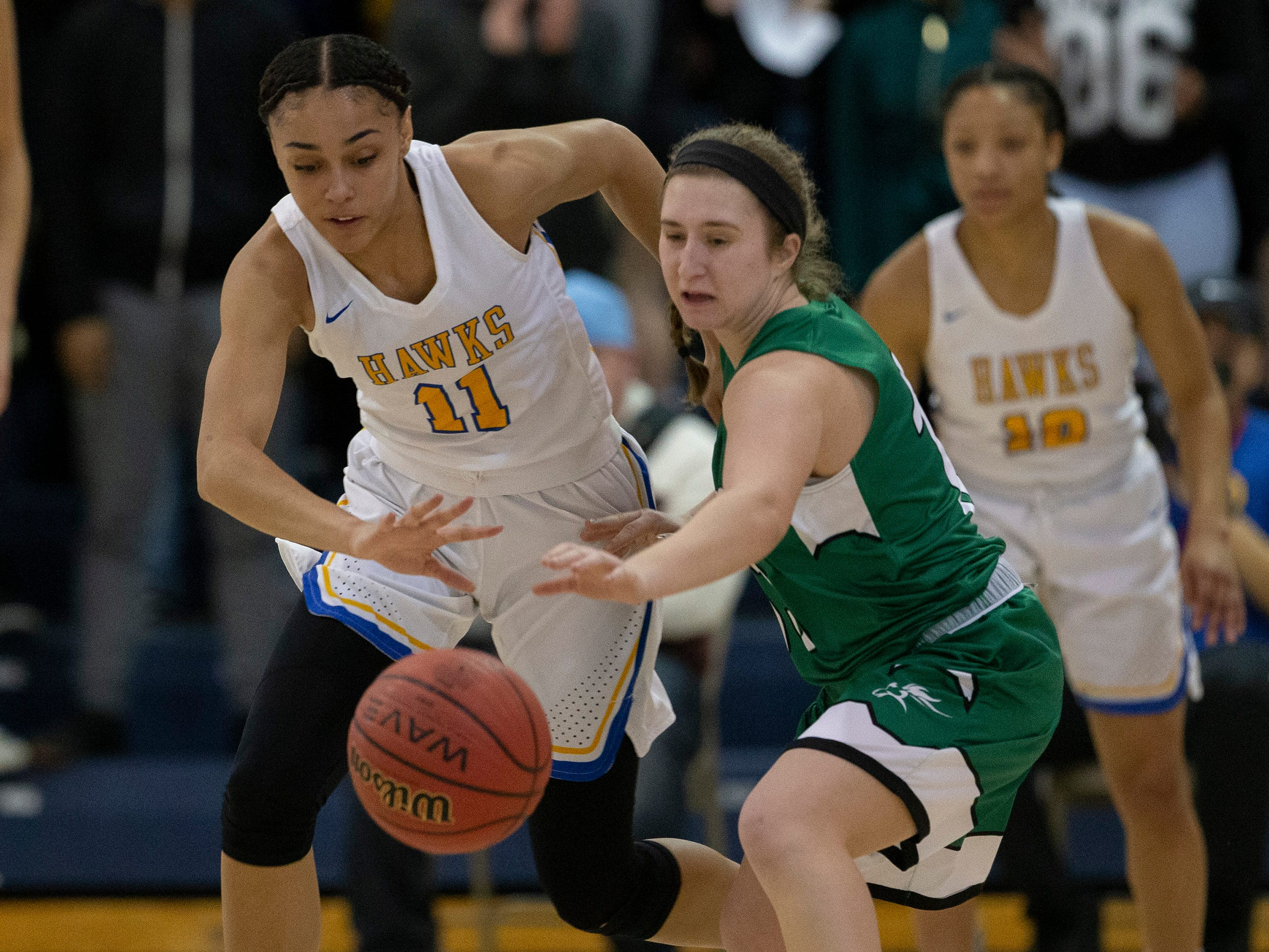 Manchester's Leilani Correa steals the ball away from Mainland's Madison Hafetz.  Manchester Girls Basketball vs Mainland in Tournament of Champions opening round game in Toms River on March 12, 2019