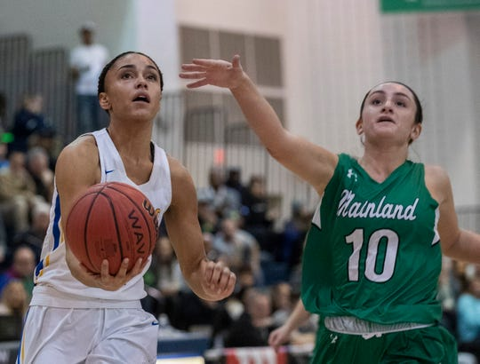 Manchester's Leilani Correa drive to the basket during first half action. Manchester Girls Basketball vs Mainland in Tournament of Champions opening round game in Toms River on March 12, 2019