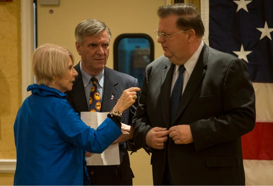 Ocean County Freeholder Director Virginia E. Haines, Ocean County Republican Chairman George R. Gilmore (center) and Deputy Freeholder Director Jack Kelly (right) confer with one another at the annual Ocean County Republican Nominating Convention at the Days Hotel in Toms River on Wednesday, March 13, 2019.
