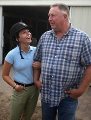 Ellen Bissey, left, talks with West Wind Stable owner Ken Fordney in this 2010 file photo in Toms River.