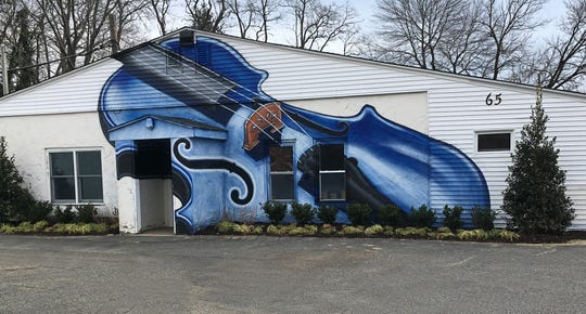 The mural on the outside of Monmouth Conservatory of Music's new home was painted by Jenna Morello.