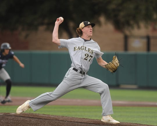Abilene High senior Ryan Johnson gets ready to throw a pitch against Richland Tuesday, March 12, 2019, in the District 3-6A opener at Abilene Christian's Scott Field.