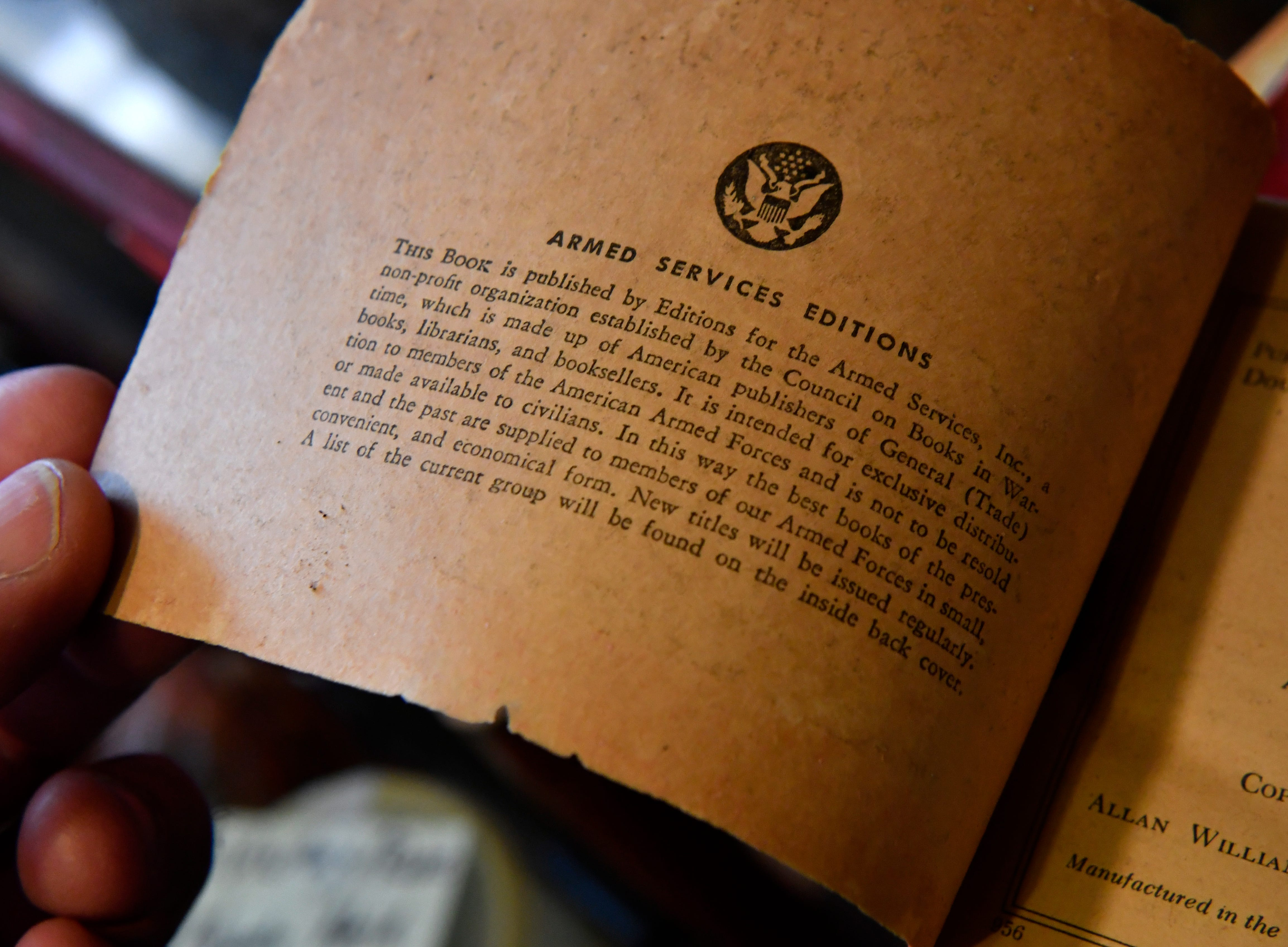 The inside cover of an Armed Services Edition paperback produced for military service members in World War II.